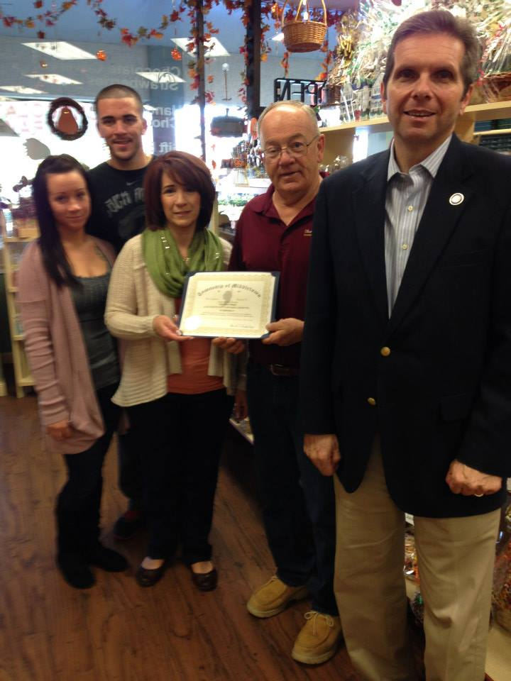 Mayor Scharfenberger presenting a certificate to Suzi's Sweet Shoppe