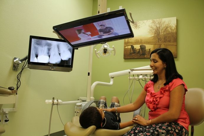 Dr Mankirat Gill with a Pediatric Patient at Aesthetic Edge, The Dental Practice