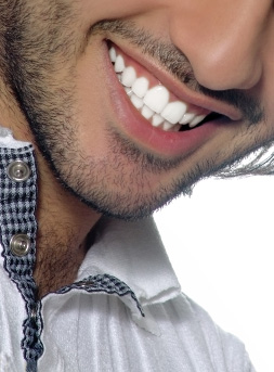 Porcelain Veneers are used to enhance your smile by cosmetic dentist in Fresn CA