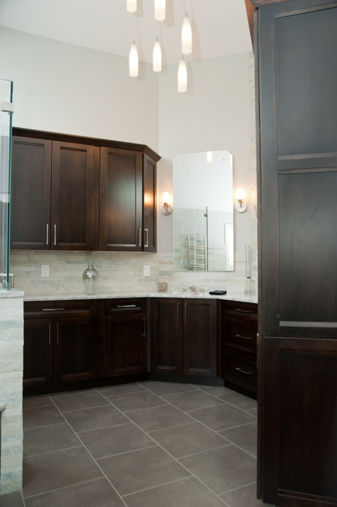 Bathroom vanity area porcelain floor and contemporary chandelier