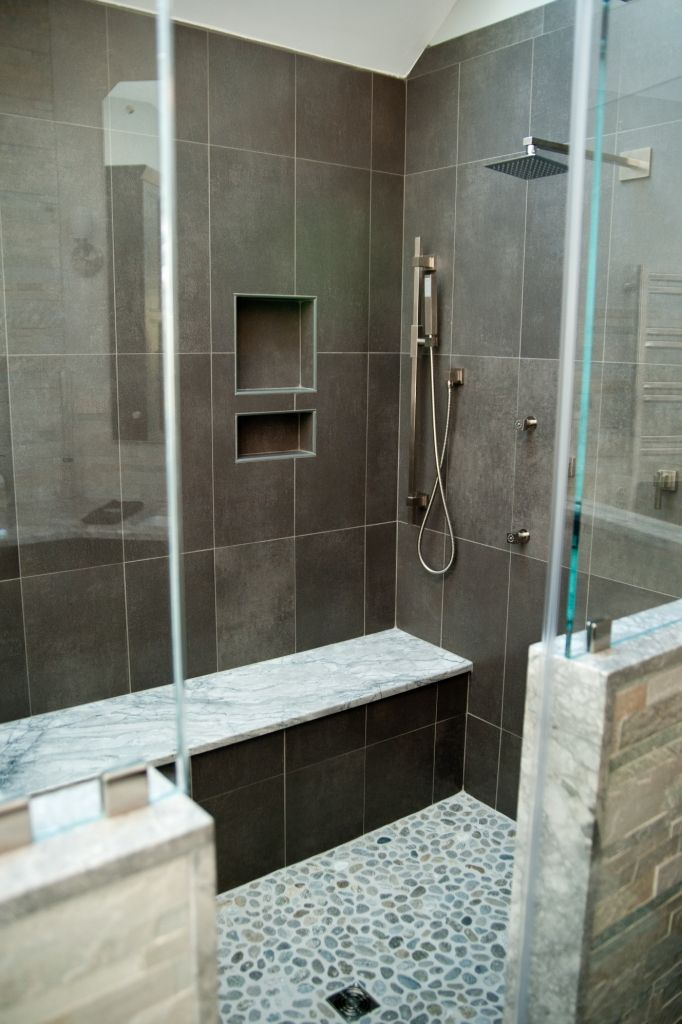 Custom shower with body sprays, bench seat, and a niche