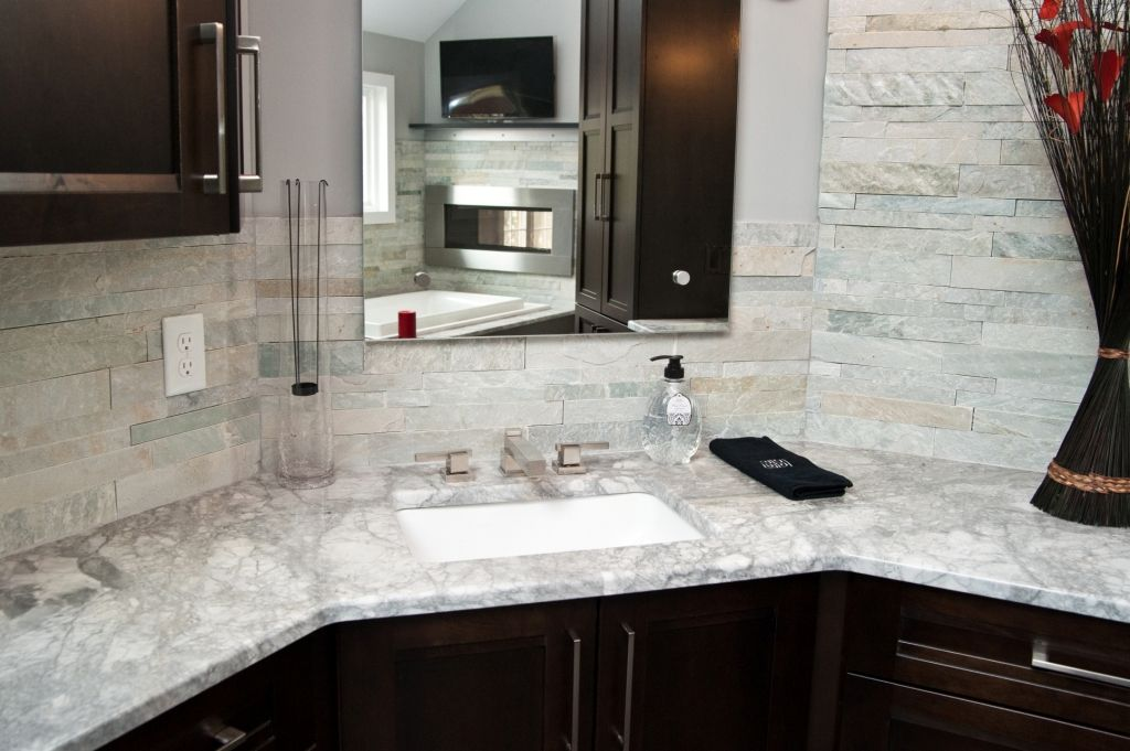 Vanity with granite top and stone backsplash