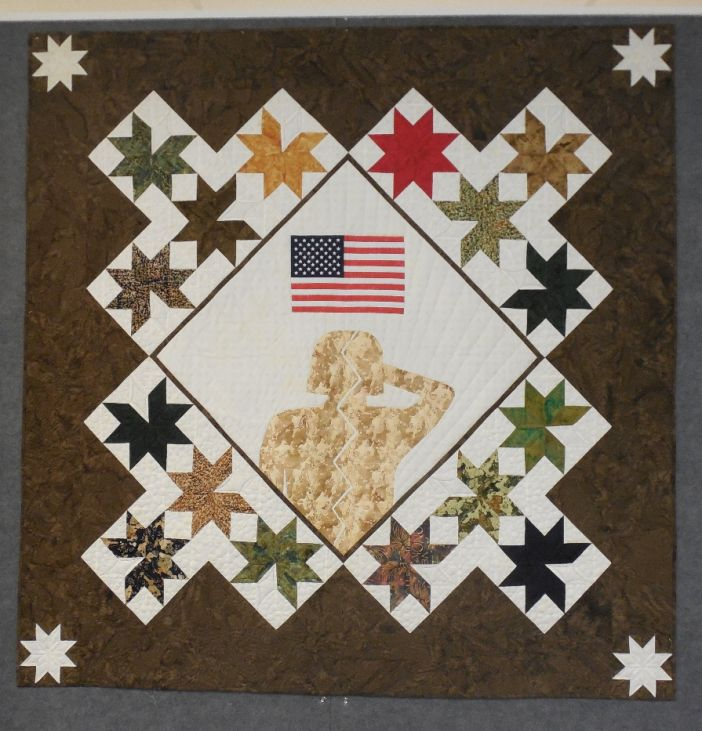 "This quilt is named ""Fractured"", representing fractured vets returning from war."