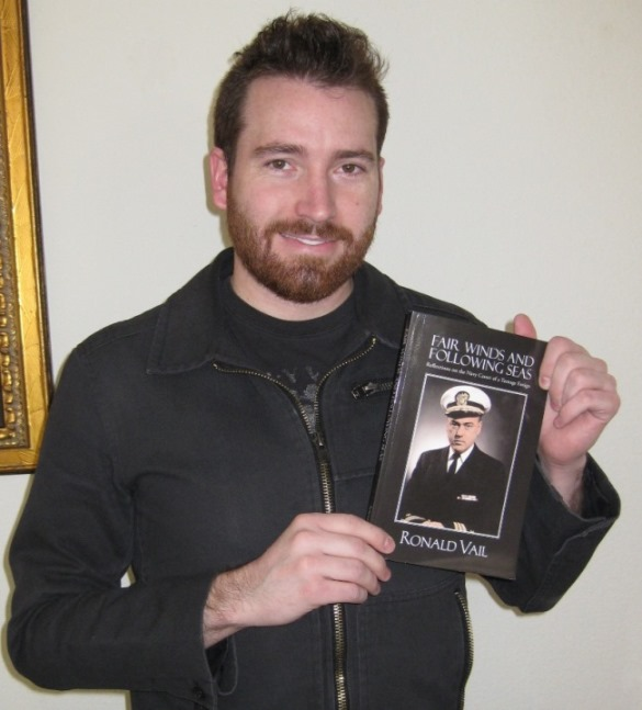 sean vail with book he inspired