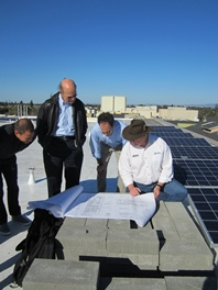 Studying plans on the JCC roof are (from left) Zach Rubin, Ric Rudman, Zack Bodn