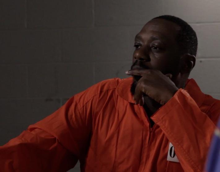 Edwin Lee Gibson as Raqmaan  in prison visiting room
