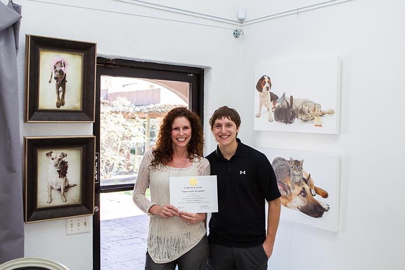 Susan Schmitz, Owner of A Dog's Life Photography with Assistant, Dan Pela