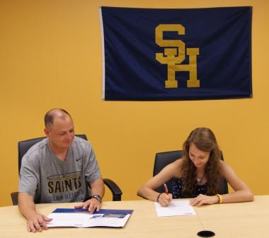 Rachel Sherman (r) signs to play soccer at Siena Heights, with Coach Oliver (l).