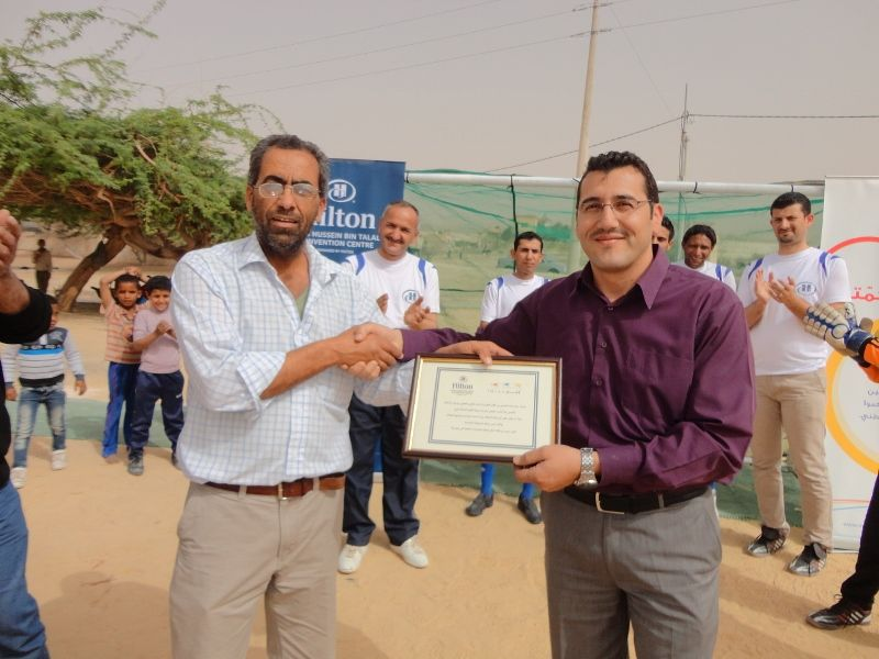 Hilton KHBTCC team member and Al-Sweimeh Boys School Prinicpal