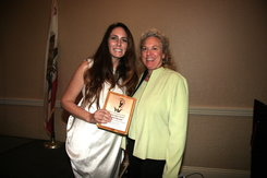 Kristin Farmer Receives Living Legacy from Women's Int'l Center VP Keri Belhon