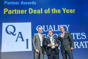 QAI's Scott Swidersky Accepts the Kofax Partner Deal of the Year Award