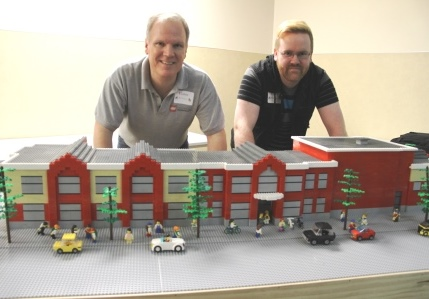 Dan Parker and assistant Andrew Frame with model of Bear Creek's new building.