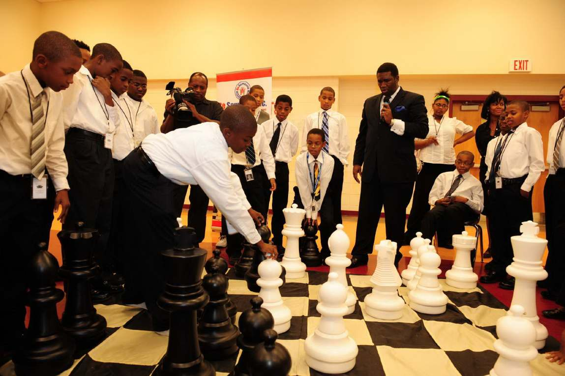 Orrin teaching students the game of chess