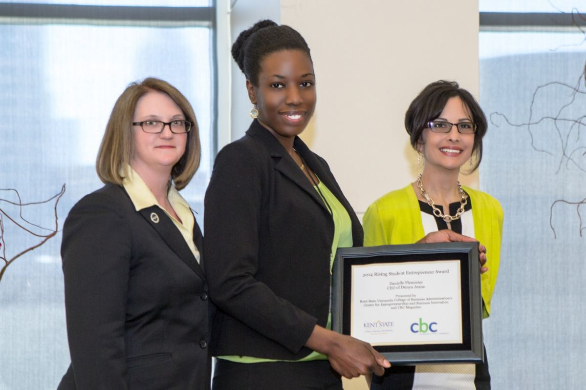 Danielle Flemister receives award from Dean Spake and Renee Deluca Dolan
