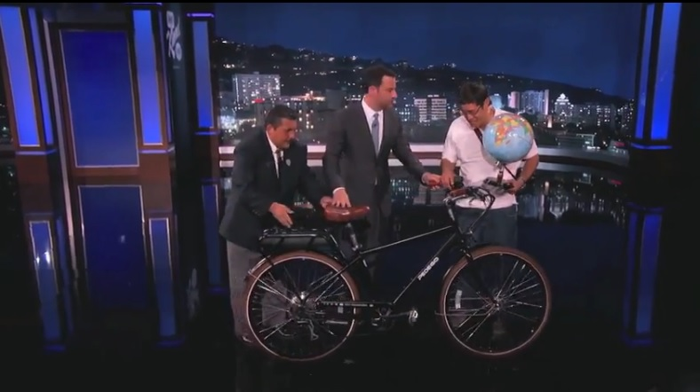 Talk show host Jimmy Kimmel awards a Pedego electric bike to Edwin.