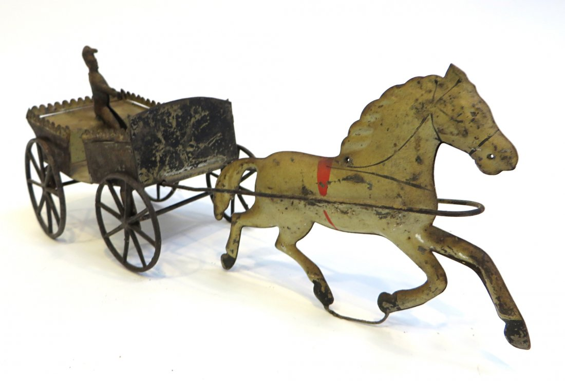 This pressed tin painted horse pulling a painted tin carriage will be auctioned