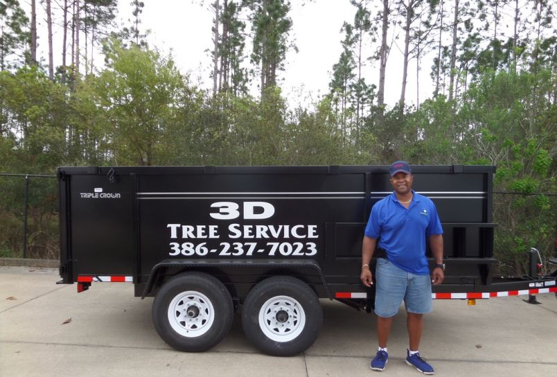 Darren Davis of 3D Tree in front of his new trailer in Palm Coast.