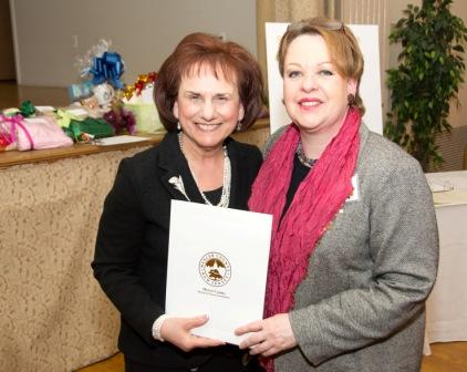Freeholder Ann M. Cannon (r.) presents an honorary certificate to Jane Latini.