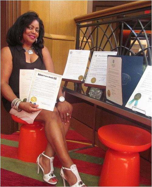 Kym Gordon Moore displaying some of the NC Mayoral Proclamations she received