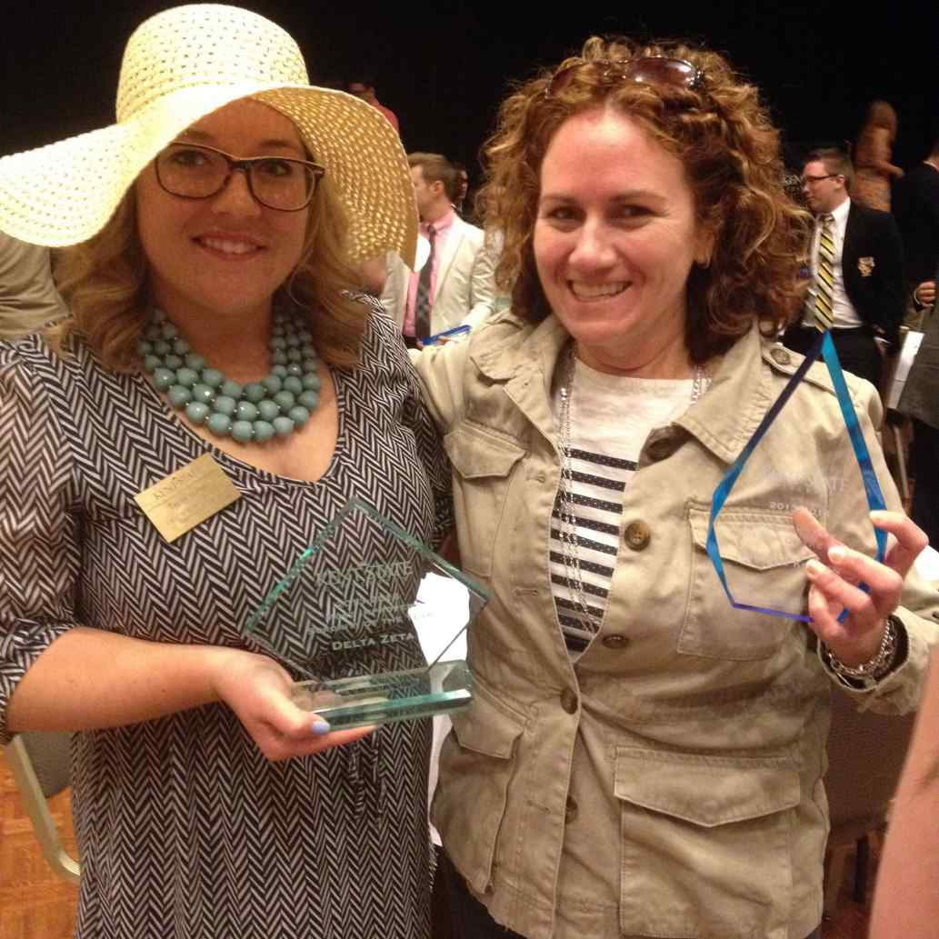 Nicole Kotlan (right) receives Outstanding Faculty/Staff Advisor