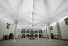 Fully-opened umbrellas provide full coverage for courtyard