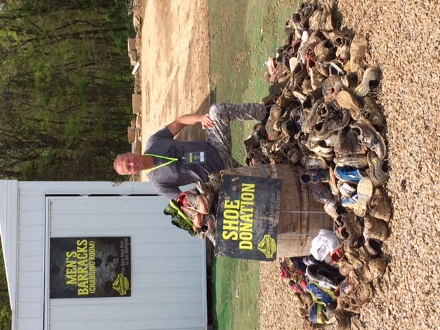 The Battleground's owner Carl Bolm with collected mud run shoes