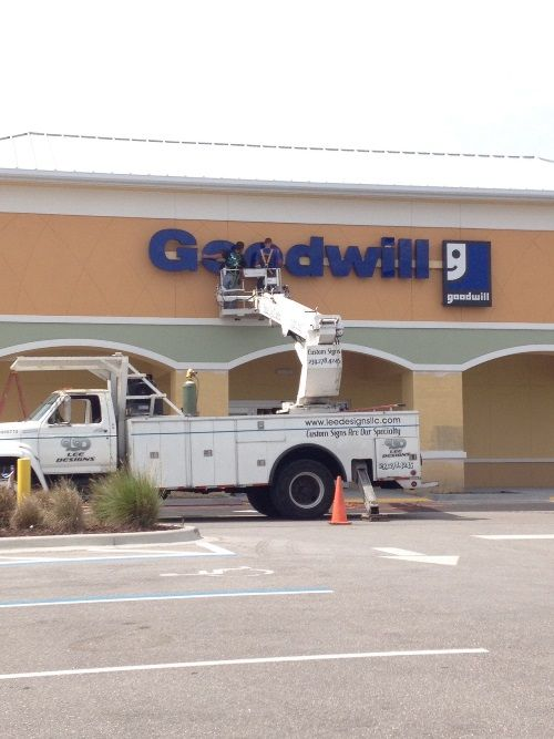Signage is hung at the new Port Charlotte Goodwill Retail & Donation Center