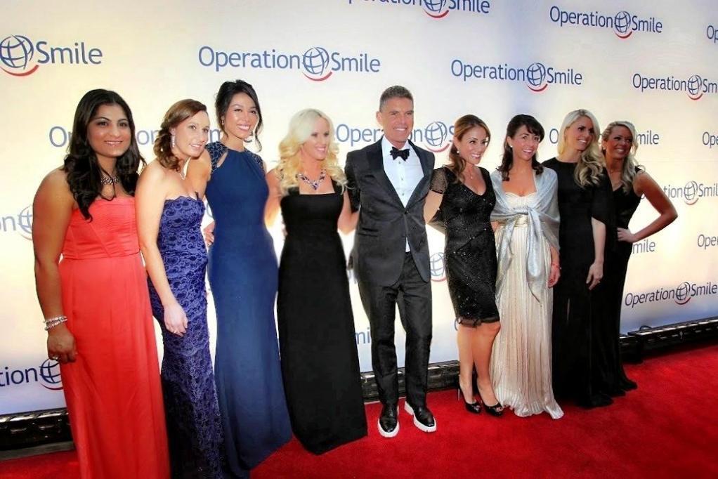 Vivid Marketing, Inc President Chrysanthi Halkiotis and guests on the red carpet