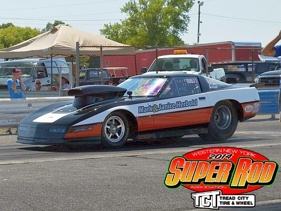 Mark Herbold starting a burnout in his Dan the Sign Man lettered Corvette