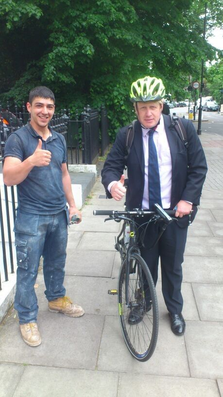 Boris Johnson (right) with cycle and Waste King recycler.