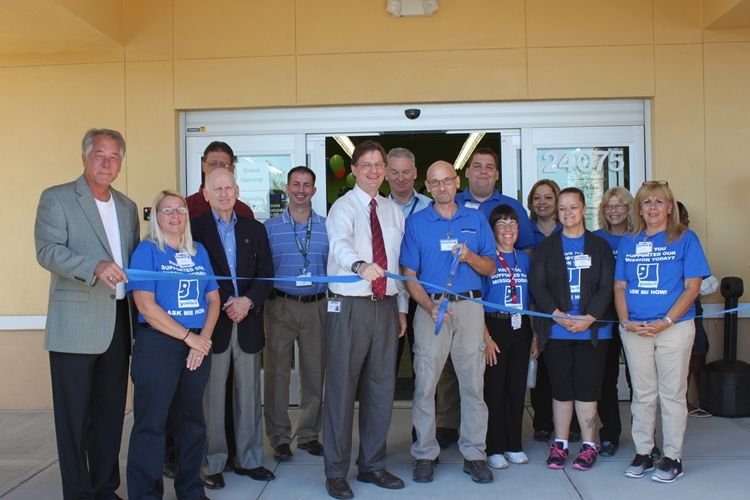 Store employees, Goodwill staff, and community leaders cut the ribbon