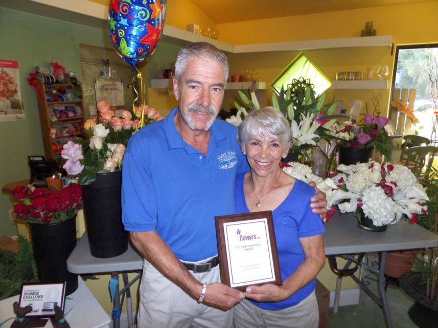 Michael Flach and Marylou Baiata of Nature Scapes & their top performance award.