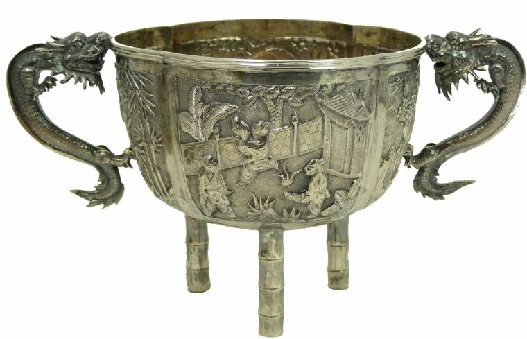 This Chinese silver dragon footed bowl carries a pre-sale estimate of $400-$600.