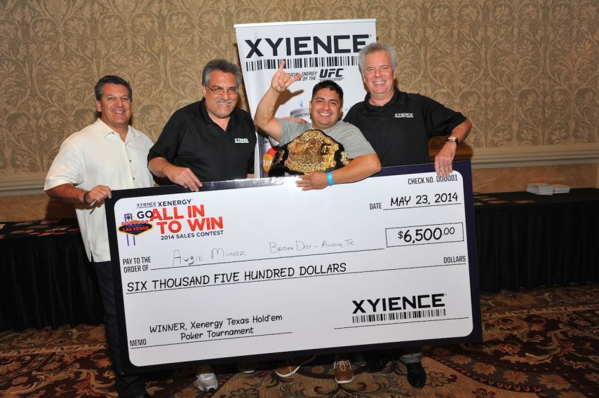 XYIENCE poker tournament winner Augie Munoz along with other XYIENCE staff