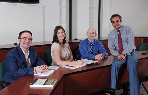 Pratim Datta, Ph.D., (far right) is Kent State University's Scholar of the Month