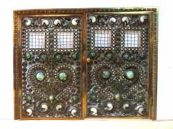 This beautiful Moorish bronze jeweled fire screen was the top lot of the auction