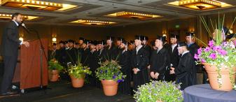Graduates listen to Spenser Villwock, IECRM CEO
