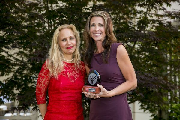 One Thousand & One Voices CFO and COO Kate Matheny (right) accepts FOR Award