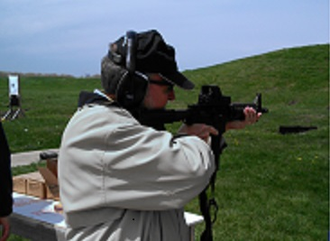 David Dumpe, Ph.D., shoots a gun as part of the FBI Citizens Academy