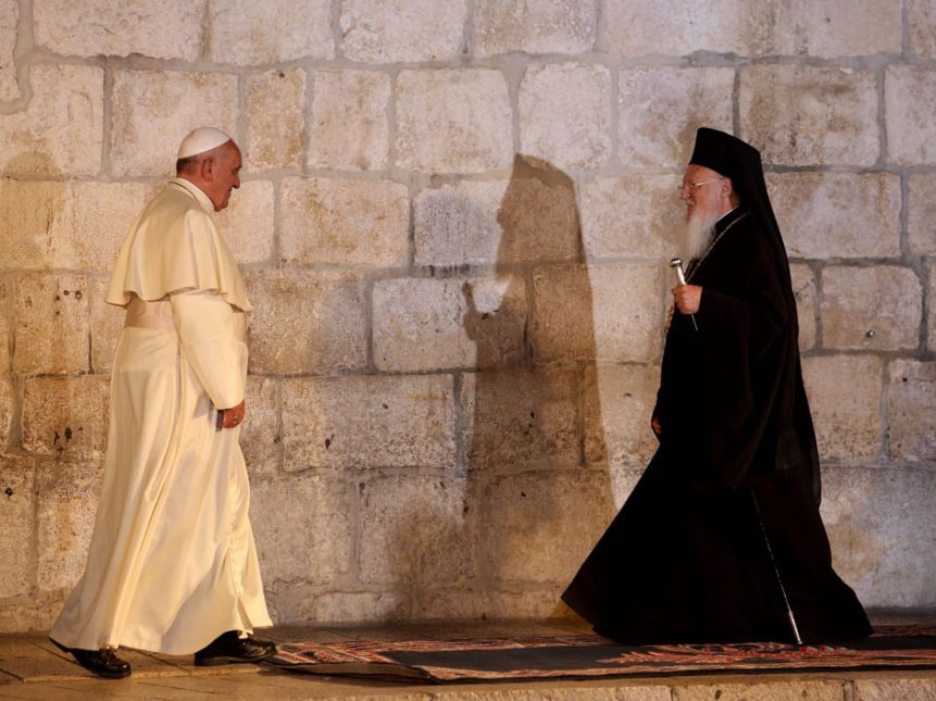 The Pope meets with Patriarch Bartholomew at the Church of the Holy Sepulchre.