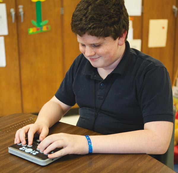 Student with Braille Plus 18
