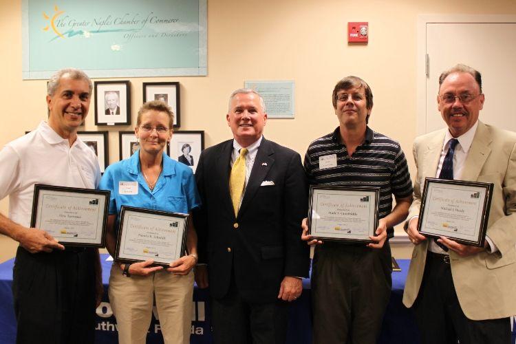 A MicroEnterprise class graduates, with Senator Richter