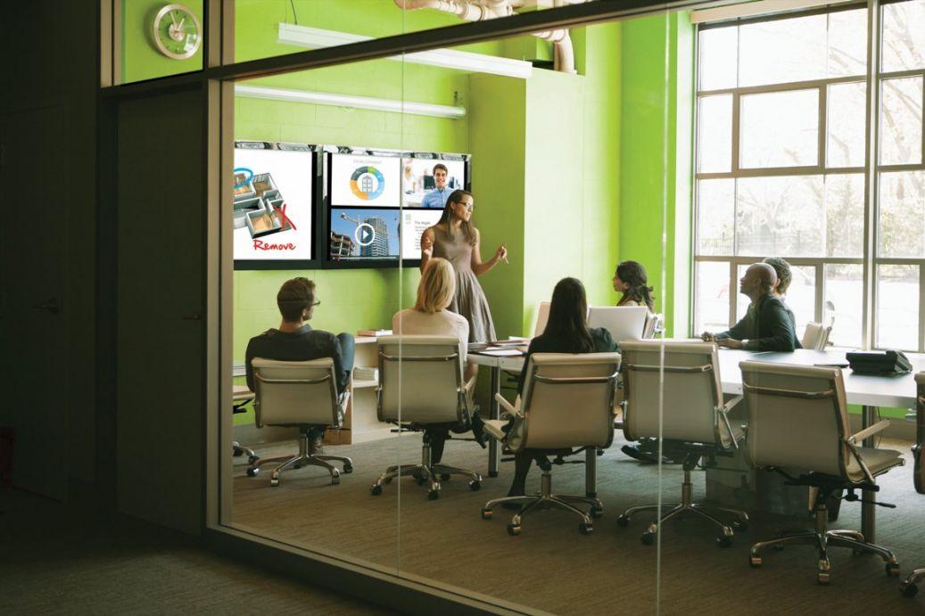 A meeting using Christie Brio Team presentation