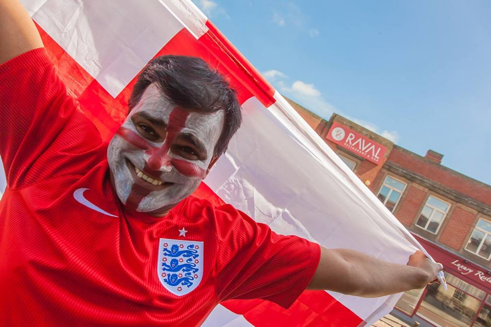 Raval manager Avi Malik gets into the spirit of the World Cup