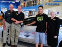 UHCF Auto Raffle winner presented with new car.