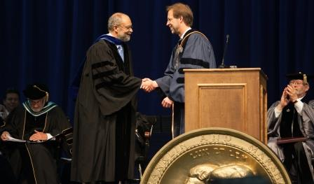 Dr. Caswell Evans (left).