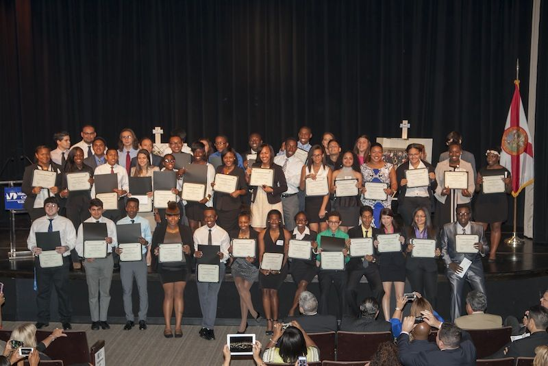 High schoolers proudly display diplomas after intensive four-week camp