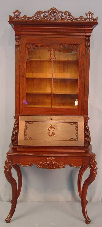This rosewood rococo ladies' secretary, signed Alexander Roux, will be sold.