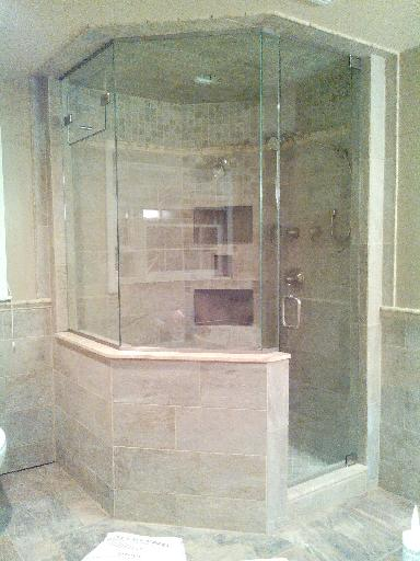 What Holds A Frameless Shower Door In Place And Is It