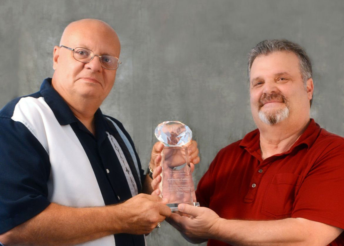 Charlie Amidon (left) presents Anthony Collier (right)  with 35-year award